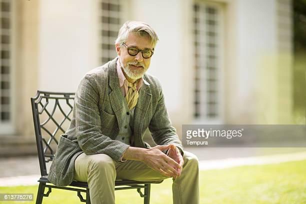 High class mature man portrait at home.