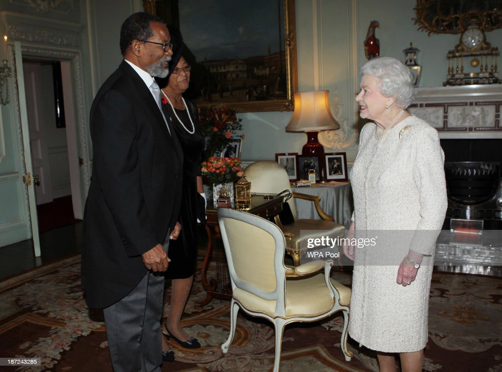 High Commissioner of Grenada Joslyn Whiteman meets Queen <a gi-track='captionPersonalityLinkClicked' href=/galleries/search?phrase=Elizabeth+II&family=editorial&specificpeople=67226 ng-click='$event.stopPropagation()'>Elizabeth II</a> during an audience with her at Buckingham Palace on November 7, 2013, London, England.