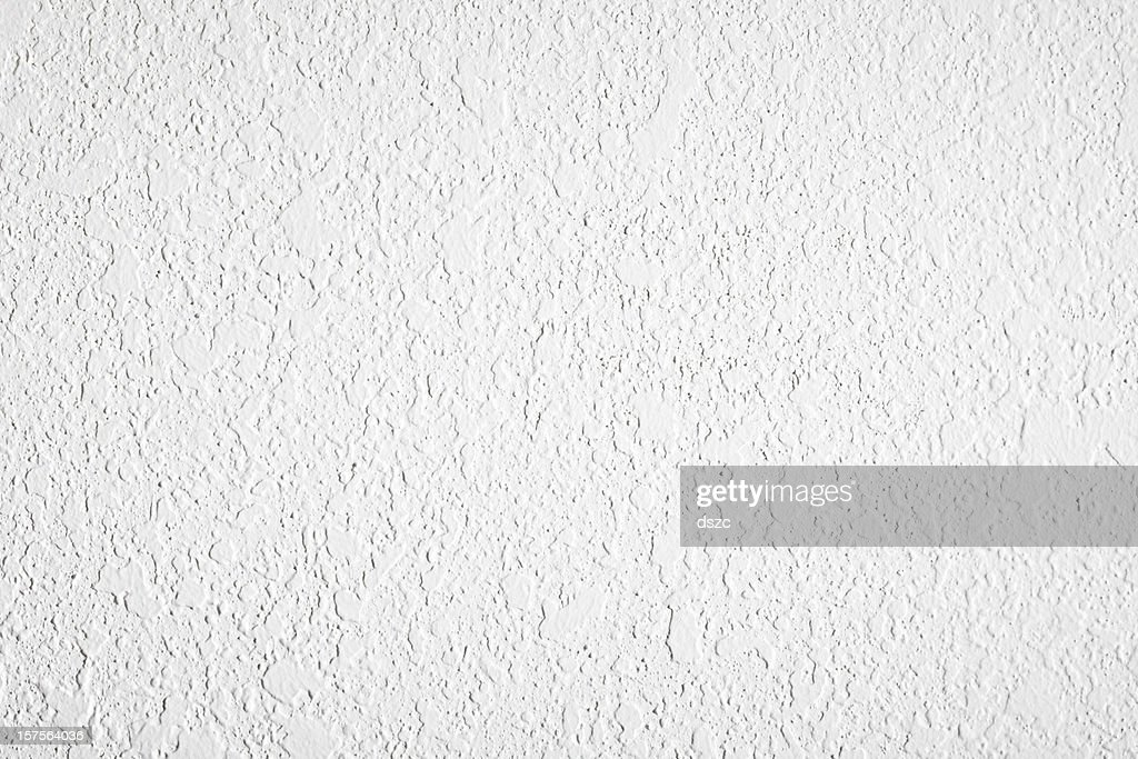 high contrast textured white plaster wall stock photo