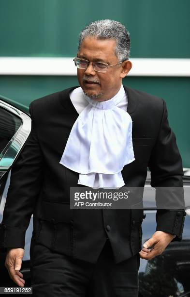High Court judge Azmi Ariffin arrives at the Malaysian Chemistry Department in Petaling Jaya outside Kuala Lumpur on October 9 as part of the ongoing...