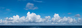 High resolution panoramic cloudscape of sunny clouds over the ocean