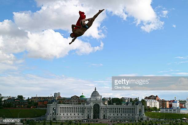 A high diver wearing a cape flies on day twelve of the 16th FINA World Championships at the Kazanka River on August 5 2015 in Kazan Russia
