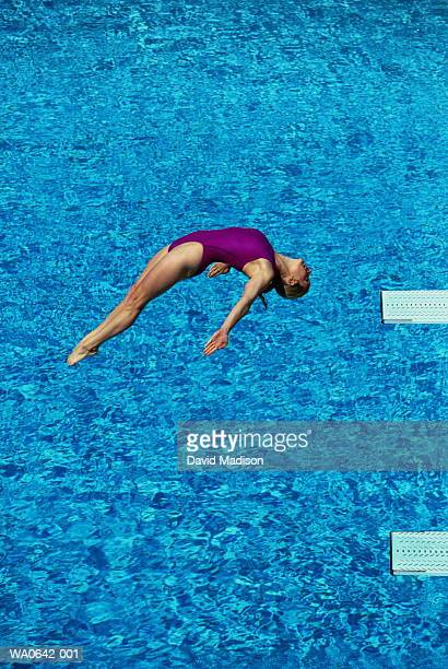 High diving, female diver above pool