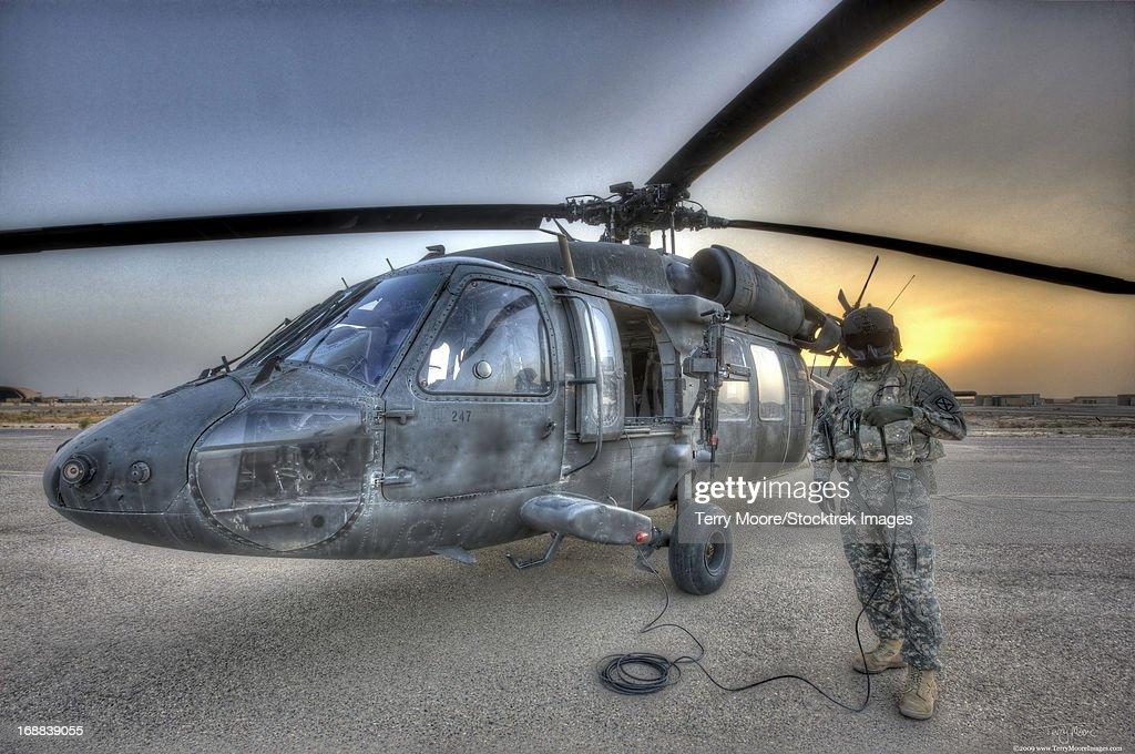 High dynamic range image of a door gunner beside a UH-60 Black Hawk, Tikrit, Iraq.