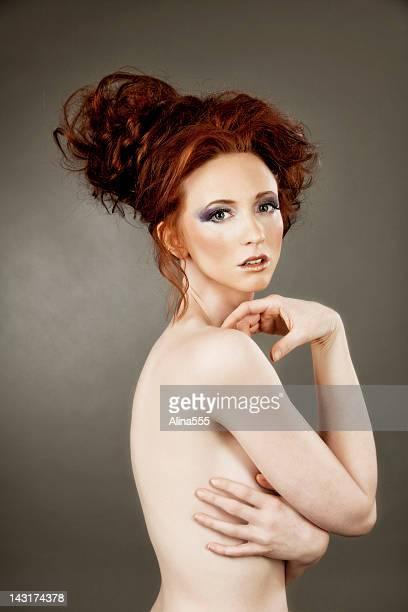 High fashion: elegant model with red hair