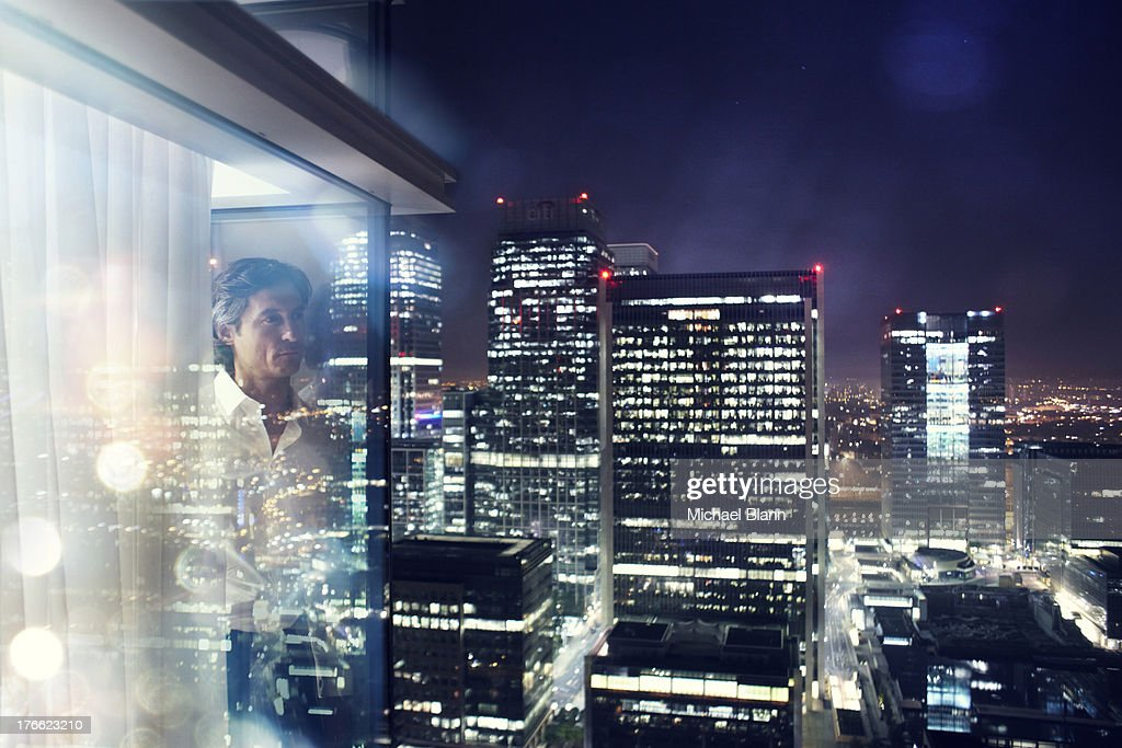 High Flying Executive in City apartment : Stock Photo