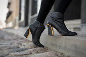 High heel boots in city