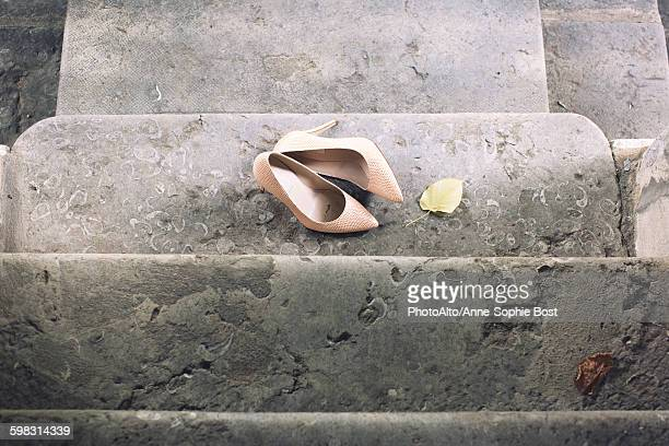 High heel dress shoes left on stairs