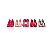 Variety of high heel shoes isolated on white background