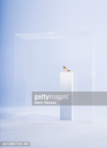 High heels on pedestal in glass cabinet : Stock Photo