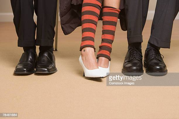 High heels out of place between mens dress shoes