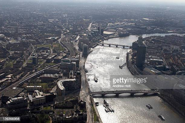 A high level and oblique aerial view of Vauxhall Bridge and south east central London.