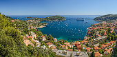 Ultra wide angle high level panorama of Villefranche bay, Nice, Cote d'Azur, France, showing Mont Boron to the West and Cap Ferat to the East, with the clear  turquoise meditaerannean sea in the bay u