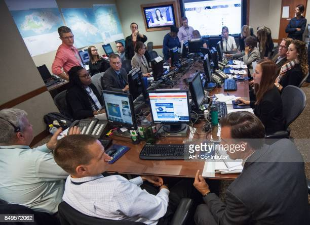 High level US State Department workers on Task Force work at various desks in the Operations Center at the US Department of State September 12 in...