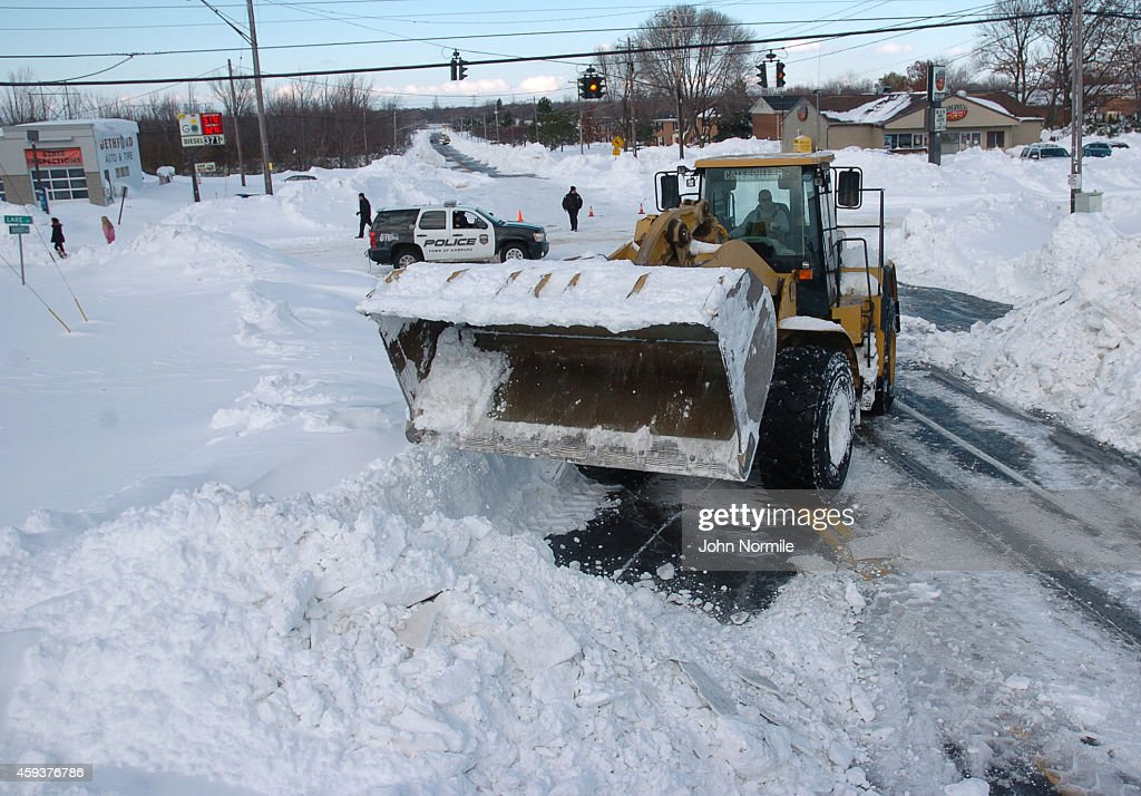 A high loader works to clear snow along McKinley Park Avenue on November 20 2014 in the suburb of Blasdell Buffalo New York The record setting Lake...