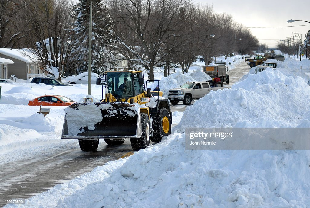 High Loader works to clear snow along McKinley Park Avenue on November 20 2014 in the suburb of Blasdell Buffalo New York The record setting Lake...
