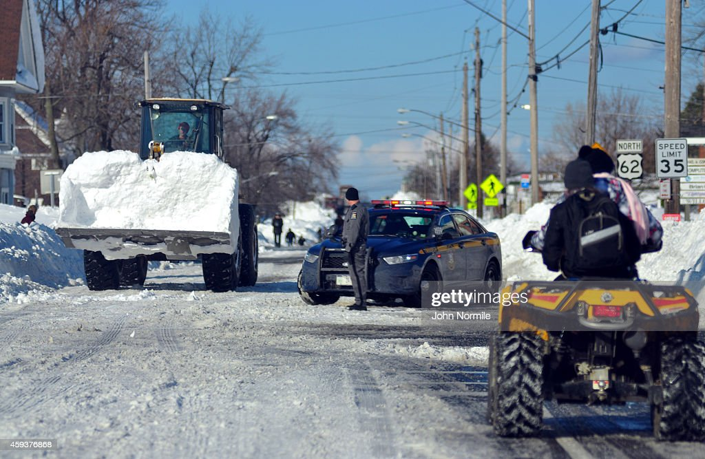 High Loader works to clear snow along South Park Avenue on November 20 2014 in the suburb of Blasdell Buffalo New York The record setting Lake effect...