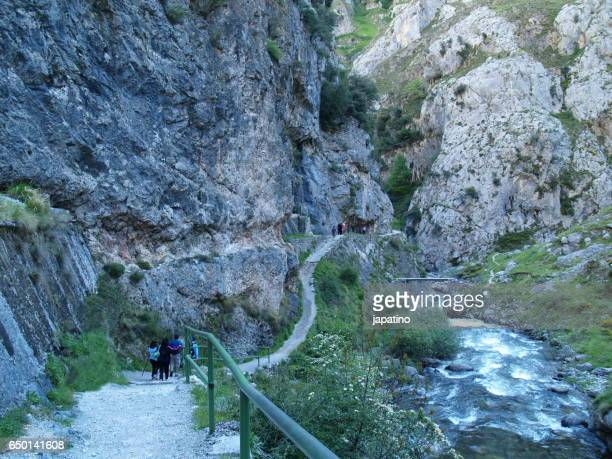 High mountain trail on the edge of the River in the Picos de Europa