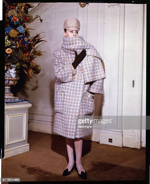 High 'n' WideStressing the 'bulky' look in coats Marc Bohan creates this ensemble for the Paris Dior collection for Fall 1963 A giant checked tweed...