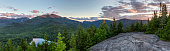 A sunset panoramic view from the summit of Mount Jo, overlooking Heart Lake, Mt. Colden, and Algonquin and Wright Peaks in the High Peaks region of the Adirondack Mountains near Lake Placid, NY