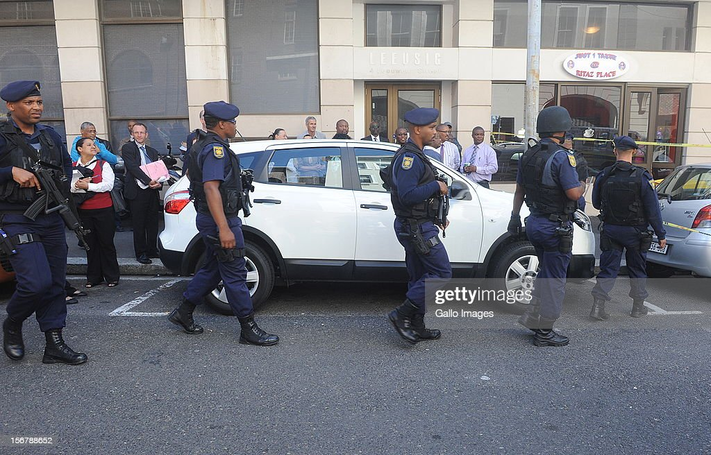 A high police guard was present following a bomb scare at the Cape Town High Court on November 21, 2012 in Cape Town, South Africa. Mngeni was found guilty of robbery with aggravating circumstances, premeditated murder and illegal possession of a firearm and ammunition, after his involvement with the murder of Anni Dewani, allegedly plotted by her British husband Shrien Dewani.