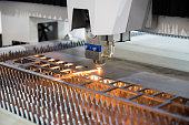 High precision CNC gas cutting metal sheet working in industry factory. Smart industry factory concept.