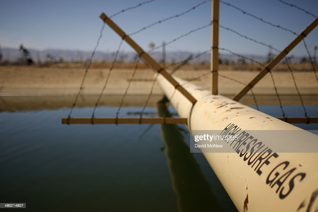 A high pressure gas line crosses over a canal in an oil field over the Monterey Shale formation where gas and oil extraction using hydraulic fracturing, or fracking, is on the verge of a boom on March 23, 2014 near Lost Hills, California. Critics of fracking in California cite concerns over water usage and possible chemical pollution of ground water sources as California farmers are forced to leave unprecedented expanses of fields fallow in one of the worst droughts in California history. Concerns also include the possibility of earthquakes triggered by the fracking process which injects water, sand and various chemicals under high pressure into the ground to break the rock to release oil and gas for extraction though a well. The 800-mile-long San Andreas Fault runs north and south on the western side of the Monterey Formation in the Central Valley and is thought to be the most dangerous fault in the nation. Proponents of the fracking boom saying that the expansion of petroleum extraction is good for the economy and security by developing more domestic energy sources and increasing gas and oil exports.