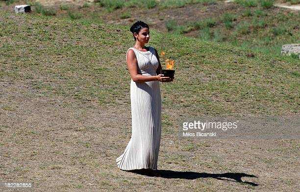 High Priest Ino Menegaki holds the Archaic Pot during the lighting ceremony of the Olympic Flame for the Sochi 2014 Winter Olympic Games at Ancient...