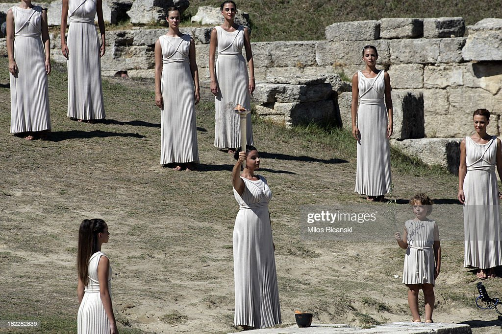 High Priest Ino Menegaki holds the torch during the lighting ceremony of the Olympic Flame for the Sochi 2014 Winter Olympic Games at Ancient Olympia on September 29, 2013 in Olympia, Greece.