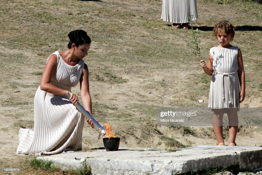 High Priest Ino Menegaki lights the torch during the lighting ceremony of the Olympic Flame for the Sochi 2014 Winter Olympic Games at Ancient Olympia on September 29, 2013 in Olympia, Greece.