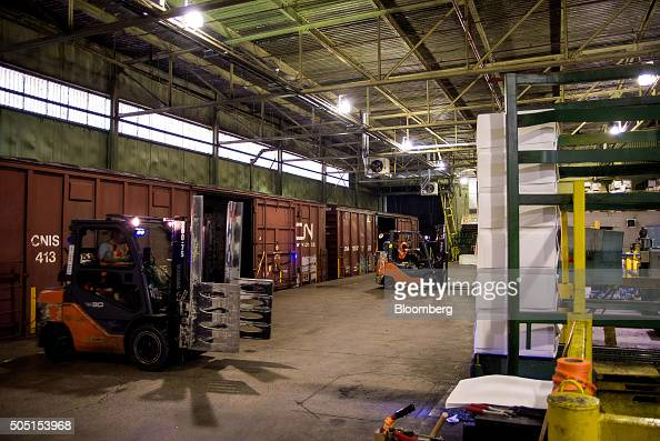High quality paper is moved into boxcars for shipment by rail at the Resolute Forest Products mill in Thunder Bay Canada Ontario on Thursday Jan 7...