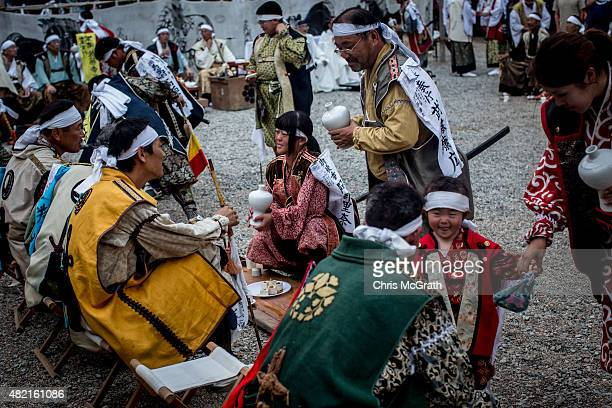 High ranked samurai are served sake during a ritual at the Nakamura Shrine after the Soma Nomaoi festival on July 26 2015 in Soma Japan Every summer...