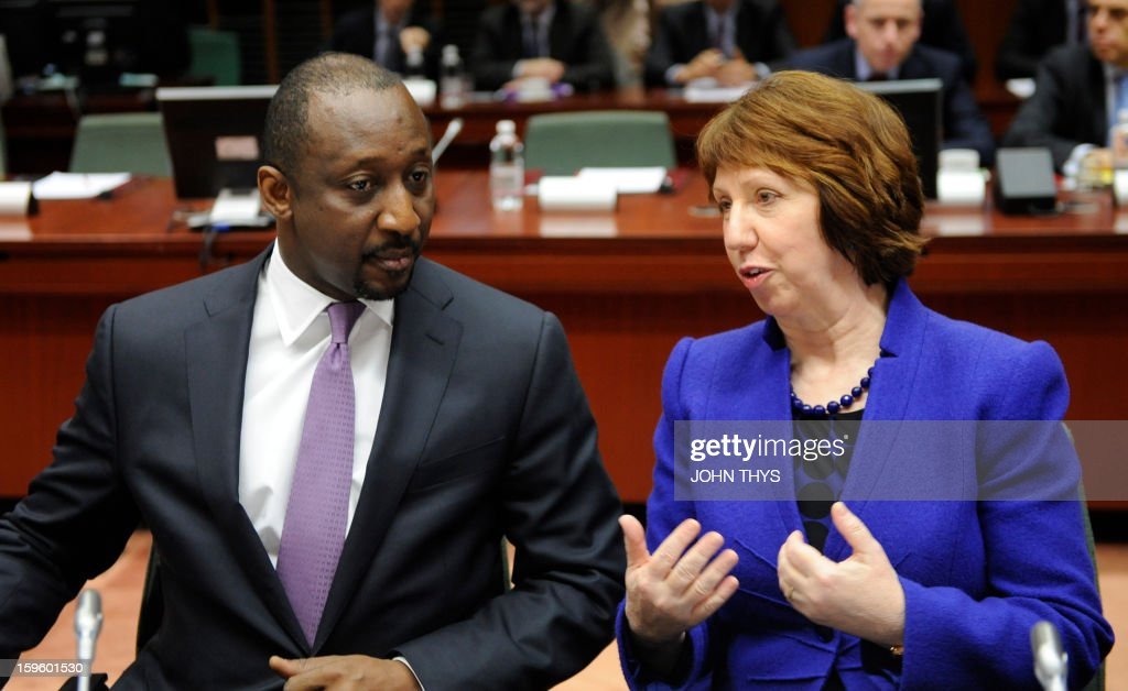 High Representative of the European Union for Foreign Affairs and Security Policy Baroness Catherine Ashton speaks with Malian Foreign Affairs Minister Tieman Hubert Coulibaly (R) before a Foreign Affairs Council on the Mali conflict meeting at the EU Headquarters in Brussels on January 17, 2013.