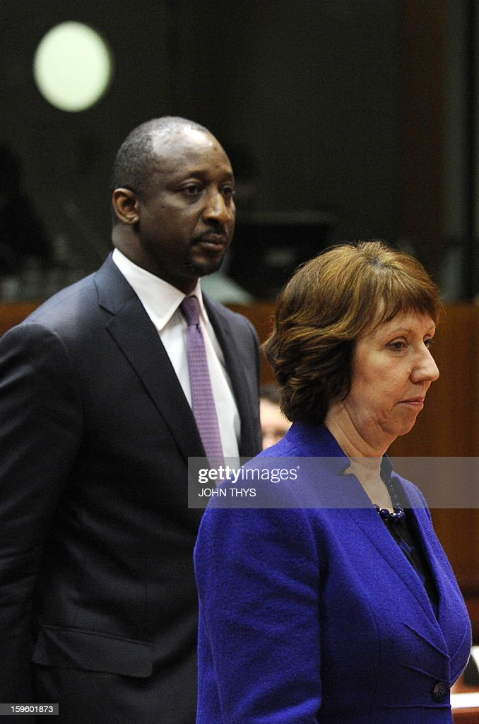High Representative of the European Union for Foreign Affairs and Security Policy Baroness Catherine Ashton and Malian Foreign Affairs Minister Tieman Hubert Coulibaly arrive for a Foreign Affairs Council on the Mali conflict at the EU Headquarters in Brussels on January 17, 2013.