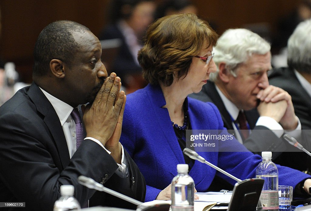 High Representative of the European Union for Foreign Affairs and Security Policy Catherine Ashton (C) and Malian Foreign Affairs minister Tieman Hubert Coulibaly (L) are pictured before a EU Foreign Affairs ministers council on Mali's conflit at the EU Headquarters in Brussels on January 17, 2013.