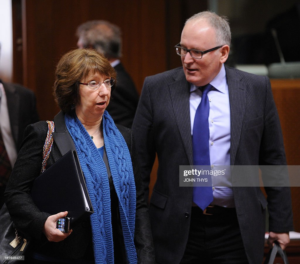 High Representative of the European Union for Foreign Affairs and Security Policy Catherine Ashton (L) speaks with Dutch Foreign Minister Frans Timmermans (R) during a Foreign Affairs Council at the EU Headquarters in Brussels on February 18, 2013. European foreign ministers discuss renewing sanctions on Syria and the possibly of lifting an arms embargo. Talks will also focus on the Mali crisis and Zimbabwe.