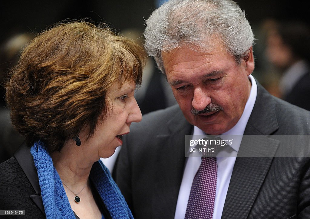 High Representative of the European Union for Foreign Affairs and Security Policy Catherine Ashton (L) speaks with Luxemburger Foreign minister Jean Asselborn (R) during a Foreign Affairs Council at the EU Headquarters in Brussels on February 18, 2013. European foreign ministers discuss renewing sanctions on Syria and the possibly of lifting an arms embargo. Talks will also focus on the Mali crisis and Zimbabwe.