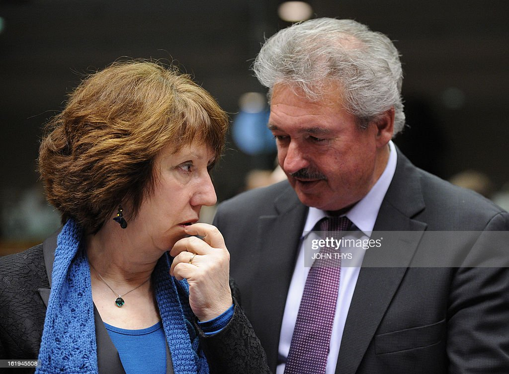 High Representative of the European Union for Foreign Affairs and Security Policy Catherine Ashton (L) speaks with Luxemburger Foreign minister Jean Asselborn during a Foreign Affairs Council at the EU Headquarters in Brussels on February 18, 2013. European foreign ministers discuss renewing sanctions on Syria and the possibly of lifting an arms embargo. Talks will also focus on the Mali crisis and Zimbabwe.