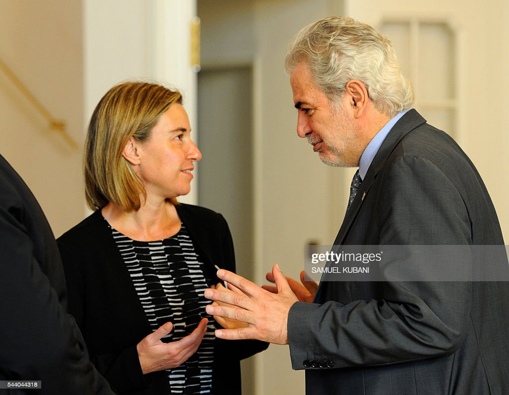 High Representative of the European Union for Foreign Affairs and Security Policy and Vice President of the Commission, Federica Mogherini (L), talks to Christos Stylianides, Commissioner for Humanitarian Aid and Crisis Management, at a photo session, during a visit of the College of European Commissioners, in Bratislava on July 1, 2016. Slovakia assumes the rotating EU presidency. / AFP / SAMUEL