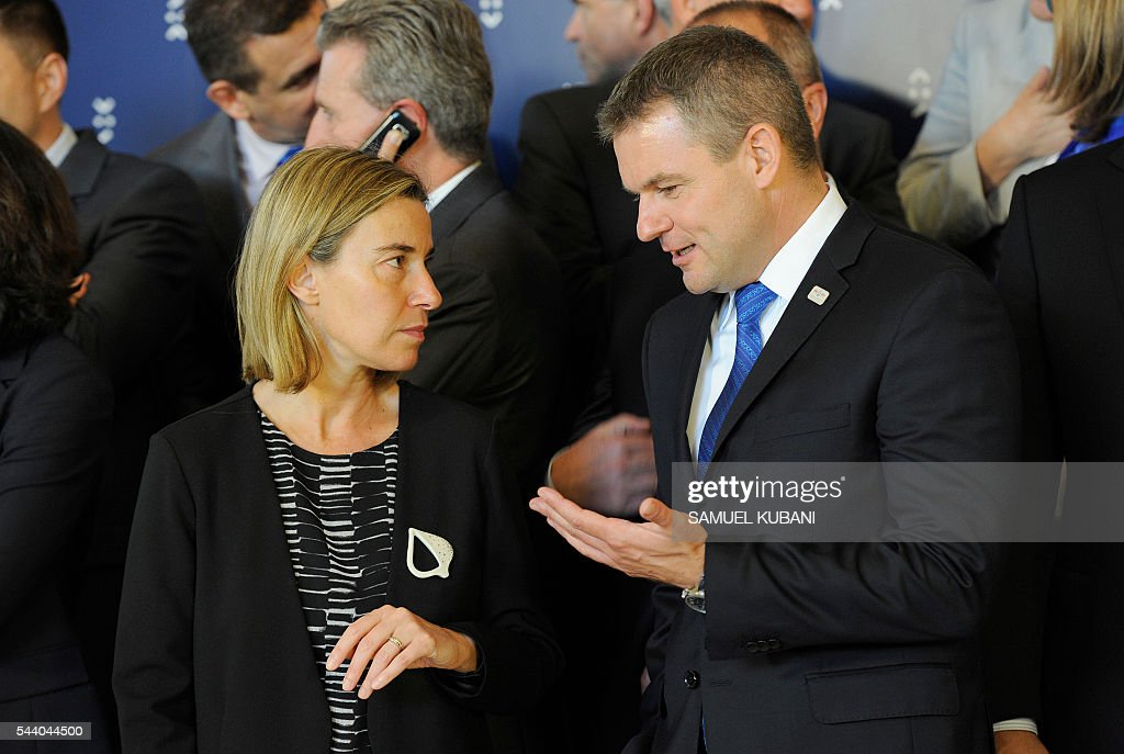 High Representative of the European Union for Foreign Affairs and Security Policy and Vice President of the Commission, Federica Mogherini (L), talks to Peter Pellegrini, Slovakia's Deputy Prime Minister for Investments, at a photo session, during a visit of the College of European Commissioners, in Bratislava on July 1, 2016. Slovakia assumes the rotating EU presidency. / AFP / SAMUEL