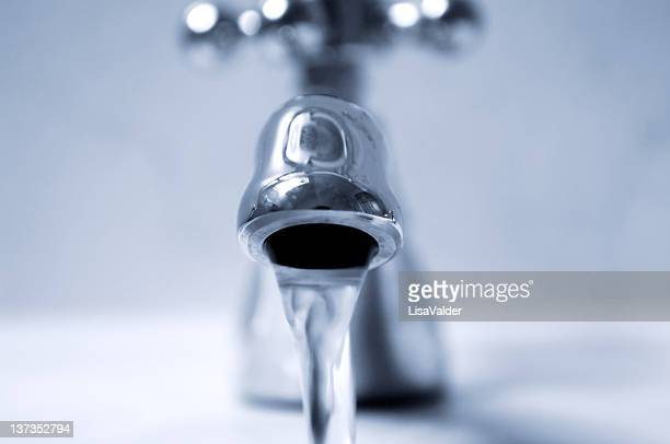 A high res photo of a faucet with running water