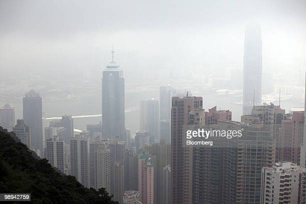 High rise buildings blanketed in haze tower above Victoria Harbor in Hong Kong China on Friday May 7 2010 Hong Kong's air pollution was the worst on...
