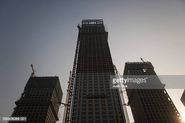 High rise buildings under construction, low angle view
