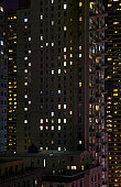 High rise city apartments at night