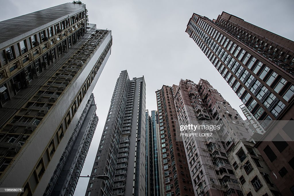 High rise residential buildings are seen in Hong Kong on November 26, 2012. Buyers have turned to parking lots to make quick gains after the government imposed a series of measures last month to try to cool the Chinese city's overheated housing market. AFP PHOTO / Philippe Lopez