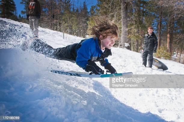 high risk, high speed, aerial snow play/sledding