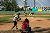 High school age boys play baseball on a field in downtown Santo Domingo the capital of the Dominican Republic April 4 2006 On an island shared with...
