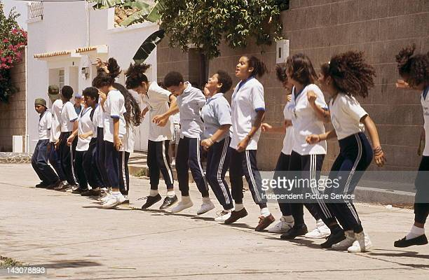 High school age children exercising Ciudad Bolivar Venezuela