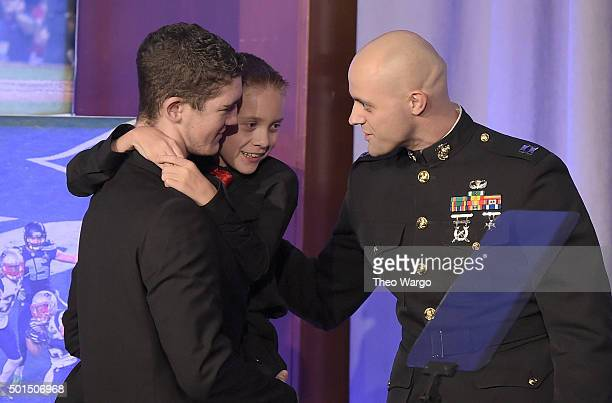 High School Athlete of the Year Hunter Gandee with brother Braden Gandee speak with US Marine Captain Mike Gangamella on stage during Sports...
