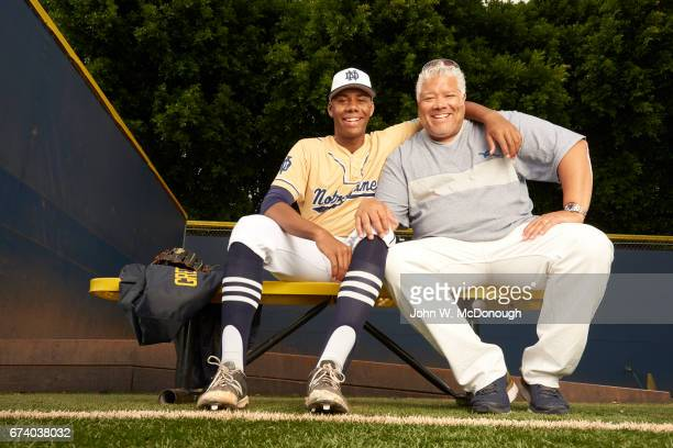 Portrait of Notre Dame HS Hunter Greene posing in bullpen with his father Russell during photo shoot at Marine Corps Memorial Stadium Greene is a...